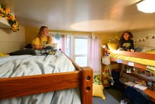 Two female students in their beds.