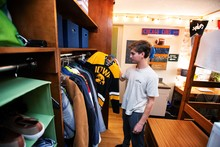 Male student looking in his closet.
