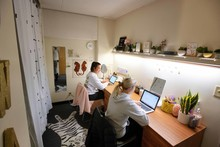 Two female students studying in their room.
